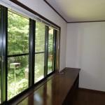 東南側洋室11.7畳から玄関ホール方向を撮影